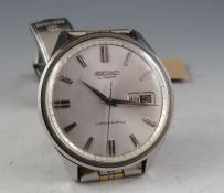 A vintage Seiko 5 sportsmatic with stainless case and two tone bracelet. The day date dial with