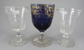A Victorian amethyst and clear rummer with petal panelbody bearing a gilt inscription (indistinct)