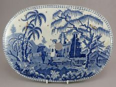 An early nineteenth century blue and white transfer-printed drainer, c.1810-15. It is decorated with