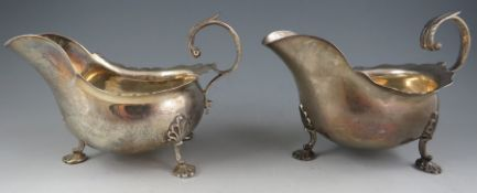 """A pair of 18th century Irish style, silver sauce boats with leaf-capped scroll handles and """"Dublin-"""