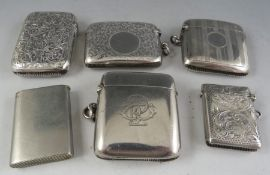 A collection of Victorian and later silver vesta cases, some with engine turned decorations. 4