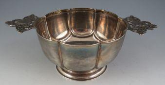 An 18th century style two handled silver quaich with pieced handles Birmingham 1899 by Samuel Walton