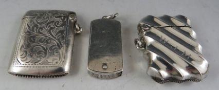 An unusual Victorian folding, silver vesta case with striker and loop suspension Birmingham 1879.