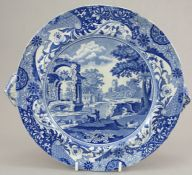 An early nineteenth century blue and white transfer-printed Spode Italian pattern hot water plate,