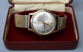 A 9ct gold Garrads of London gents automatic wristwatch with calendar aperture