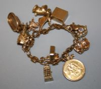A 20th century 9ct yellow gold charm bracelet of thirteen mostly 9ct charms including, concorde,