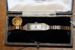 Rolex. A ladys 18ct gold wristwatch, the rectangular dial with Arabic numerals, the 18ct gold cast