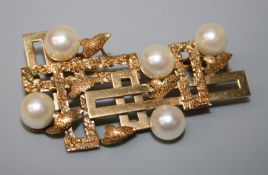 A gold and cultured pearl brooch of abstract design, polished panels and five cultured pearls.