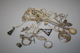 An assortment of silver chains of varying forms some with affixed pendants together with other items