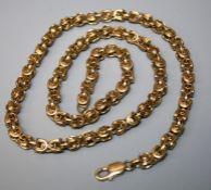 A 9ct gold fancy link longchain of heavy hooped links. 60cm long 72.6g