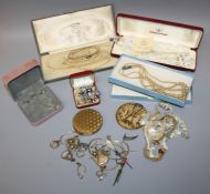 A collection of costume jewellery including shaped and engraved mother of pearl together with