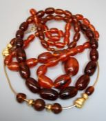 A graduated string of Amber type beads together with one other string of amber type beads. Note: