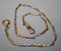 An early 20th century gold and platinum watch chain of fancy figure of eight links to sprung clip