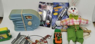 Toys including Supercar, Tinplate, Bugs Bunny Rocket, Louis Marx lion, Donald Duck snow storm, Tom