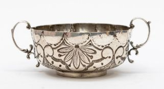 A Continental white metal stamped 830 two handled loving cup, the sides chased and repousse with