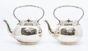 A pair of Sheffield plated tea kettles, with raised beaded rims, mushroom shaped ebony finials,