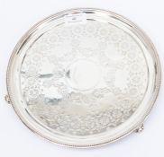 A Victorian silver circular salver, engraved geometric decoration, on three scroll feet, by George