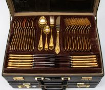A briefcase containing gold plated Royal Solingen canteen of cutlery along with a breifcase of