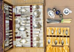 A collection of plate including a cased set of flatware, strainer, cruet set, boxed set of shell