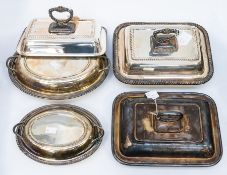 A collection of five various silver plated entrée dishes, with lids