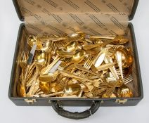Two cases of assorted Bestecke Solingen gold plated and stainless steel cutlery, various settings