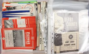 A collection of assorted football programmes and memorabilia to include: Derby County Supporters