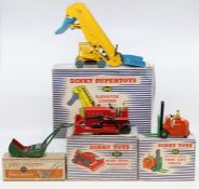 Dinky: A collection of four boxed Dinky Toys to comprise: Lawn Mower, 751, green body, discoloured