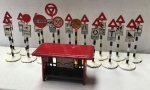 Dinky: A collection of Dinky diecast road signs. sixteen white base signs plus one yellow base