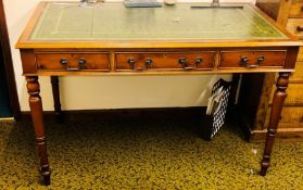 A late Victorian mahogany writing desk, circa 1890, slight oversailing top with a leather inlay