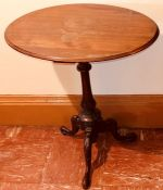 A 19th Century oak wine table, oval top above a baluster column raised on a three carved cabriole
