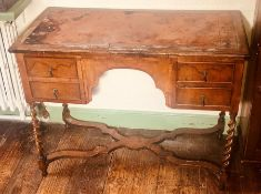 A Queen Anne revival walnut and oak kneehole desk, slight oversailing top with leather writing