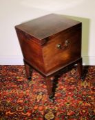 A George III mahogany wine cooler, circa 1770, in square form, lid opening to lead line interior