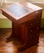 A Victorian walnut and satinwood inlay davenport desk, circa 1860,hinged slope inset with green
