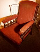 A late Victorian Aesthetic mahogany open armchair, line carved frame, padded arm rests, seat and
