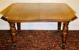 A late Victorian oak extending dining table, circa 1890, octagonal moulded edge top, wind up