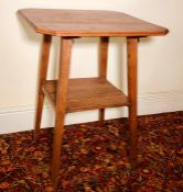 An Arts and Crafts oak hall table, octagonal form top, raised on tapered supports united with a