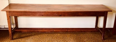 A late 19th Century grained pine farmhouse kitchen table, raised on block tapered supports united