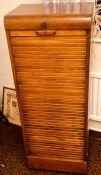 A 1920's oak tambour filing cabinet. 116cm H x 44cm W x 36cm D Condition report: Good overall