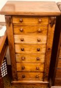A Victorian walnut Wellington chest, circa 1860, oversailing rectangular top, feathered carving to
