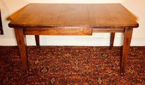 An early 20th century oak extendable dining table, moulded edge top, wind up extending movement,