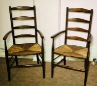A pair of Arts & Craft Cotswold School ash ladder back chairs, circa 1900, curved back rails on a