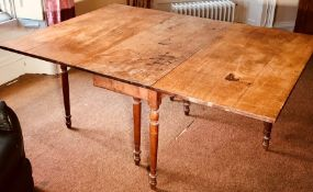 A mid 19th Century oak dropleaf table, circa 1850, rectangular form raised on turned supports.