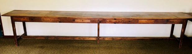 A 19th Century grain pine farmhouse long table, rectangular top, above six drawers to the frieze,