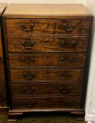 A George III/IV oak secretaire, circa 1820, caddy top moulded edge above a fall front two dummy