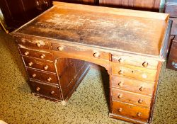 A Victorian oak grained kneehole desk, circa 1880, three quarter gallery and moulded edge top,