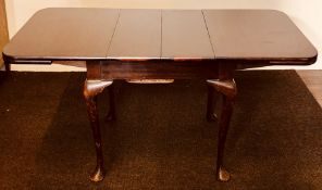 A George III revival mahogany drawleaf table, in Thomas Chippendale design, raised on tapered