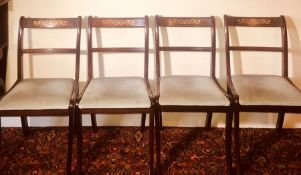 A set of four Victorian revival mahogany dining chairs, rectangular rail backs with gilt painted