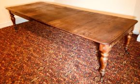 A Victorian mahogany extending dining table, circa 1860, rectangular moulded smooth edge top with