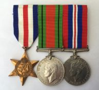 WW2 British France & Germany Star, Defence Medal and War Medal. All with ribbons mounted on a pin