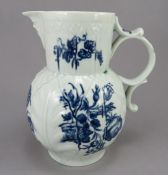 An eighteenth century blue and white transfer-printed porcelain Worcester mask jug, c. 1760-70. It